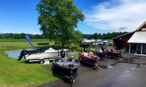 boats lined up in a parking lot