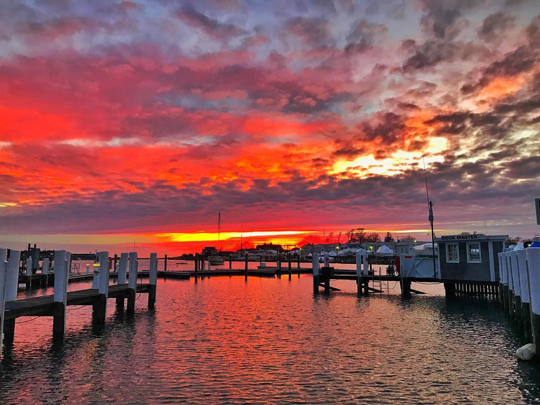 Striking red and yellow colors in sunset over marina